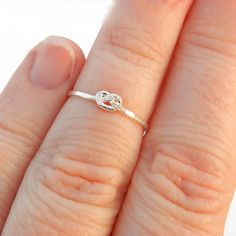 Love knot silver ring, sterling silver first knuckle ring, hammered above knuckle infinity ring, pretzel knot jetteam mid finger ring. $19.00, via Etsy.