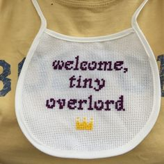 Made a friend's new baby this cute little bib. Easy cross stitch. The lettering is royal purple, as is befitting a new ruler.