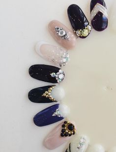 Bio Sculpture colour gel nail designs with rhinestones and gold and silver jewels.