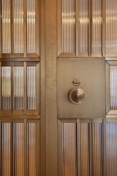 Upper West Side Apartment, NYC Photo: Laurie Lambrecht Nanz brass doorknob, custom bronze channel, Bendheim ribbed glass door.