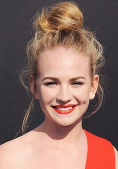 Britt Robertson's messy topknot and matte orange-red lip