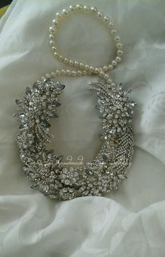 A Unique Good Luck Wedding Horseshoe. Made with Rhinestone brooches which coordinates with the sparkle on the Brides dress.