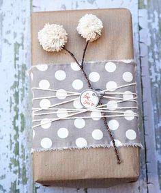 brown bag, fabric, stick, string, tag and pom poms