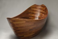 Front view of sculpted wooden bathtub by Seth Rolland custom furniture design