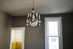 ABM studio: dining room // I'm in love with this grey color and how it pops against the white trim! Oh, and the original chandelier!!