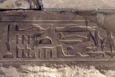 a helicopter, submarine, and spaceship on an ancient egyptian plaque