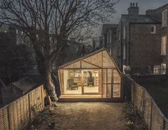 Designed by British studio Surman & Deane, 'Writer's Shed' feels simultaneously cozy and wide-open thanks to its small footprint, wood stove...