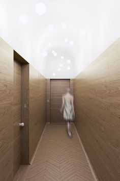 PERŁA BREWERY APARTMENTS | minimal hotel corridor design, oak, wood wall panels, chevron wood floor, hotel door design