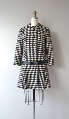 Vintage 1960s black and white wool houndstooth coat with mod Nehru collar, dropped waist with bow belt and pleated skirt. Lined with pockets. A warm coat that is best for cold weather. --- M E A S U R E M E N T S ---  fits like: small shoulder: 16 bust: 32-36 hip: up to 40 sleeve: 21 length: 35 brand/maker: Peabody House condition: excellent  ★ layaway is available for this item  ➸ More vintage coats http://www.etsy.com/shop/DearGolden?section_id=5800175  ➸ Visit...