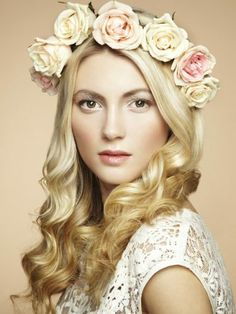 Bridal hair and makeup is stunning. Pale roses, dewy complexion.