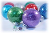 Glitter ornaments: clear ornaments (Michael's or other craft store), glitter & floor cleaner.  Yup, floor cleaner.