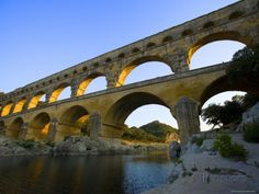 Image from http://imgc.allpostersimages.com/images/P-473-488-90/22/2241/IFHZD00Z/posters/jim-zuckerman-the-pont-du-gard-roman-aquaduct-over-the-gard-river-avignon-france.jpg.