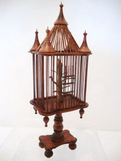 David Krupick. WOW !!  I bought a simpler one from Dave at a show back in the 1980s. The most remarkable parakeet I've ever seen lives in it.  Christy