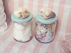 Pretty reuse recycle glass jars with painted lid and attached items