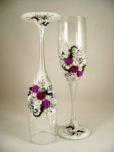 Gorgeous wedding champagne glasses, hand decorated with fabric roses and pearls, in purple, white, black and silver