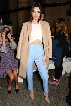 Kendall Jenner opted for a camel coat to coordinate with the nude stilettos, anchoring her cream crop top and powder blue trousers