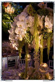 Orchids moss silver candlestick tall centerpiece garden wedding centerpiece