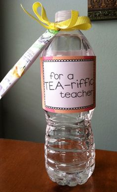 Print and attach label  Tie tea packet around bottle of water with ribbon