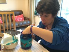 Emma concentrating on painting her jar - this one is in memory of Hazel and Mary.