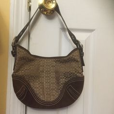 Coach shoulder bag Cute authentic coach purse with signature C's on light brown canvas framed in chocolate brown suede. Brown leather handle with silver hardware and zipper closure. One zipper pocket inside. Coach Bags Shoulder Bags