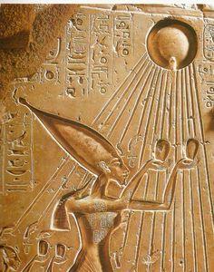 detail of Akhenaten, Nefertiti & daughter giving homage to the sun, the sacred disk Aten.