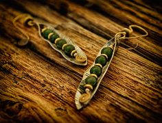 Ripe earrings by Q. Miller Handmade Jewelry. American Made. See the designer's work at the 2016 American Made Show, Washington DC. January 15-17, 2016. americanmadeshow.com #americanmadeshow, #americanmade, #jewelry, #earrings, #green