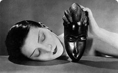In Man Ray photographed Kiki de Montparnasse holding an African mask, which later inspired the photo for Jean Paul Gaultier's Classique fragrance ad. History Of Photography, Vintage Photography, White Photography, Fashion Photography, Photography Tips, Street Photography, Landscape Photography, Nature Photography, Wedding Photography