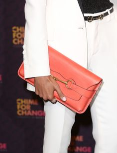 Freida Pinto Leather Clutch  Freida Pinto's coral clutch brightened up her crisp white suit.  Brand: Gucci