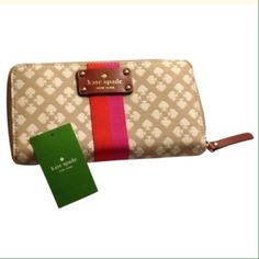 """♠️kate spade ♠️ wallet NWT Brand new!!!! ♠️ new kate spade Neda Classic Spade zip around beige and cream wallet.   Pink and orange accent stripe with brown leather nameplate and zipper pull.  This wallet has plenty of room for all your cards and cash. 12 credit card slots, zip coin purse, 5 full length bill compartments.  Exterior slip pocket on the back.  Measures approximately 7 3/4"""" length by 4"""" height by 1"""" depth. kate spade Bags Wallets"""