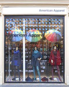 Rainy Day window in Toulouse, France.  #AmericanApparel #display #merchandizing #rain #umbrellas