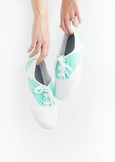 DIY Painted Mint & White Saddle Shoes | dreamgreendiy.com  Learn how to transform a pair of $6 white canvas sneakers into snazzy saddle shoes using nothing but acrylic paint!