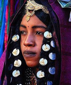 The Tuareg (Twareg or Touareg; endonym Imuhagh) are group of largely matrilineal semi-nomadic, pastoralist people of Berber extraction resid. We Are The World, People Around The World, Around The Worlds, Black Is Beautiful, Beautiful World, Beautiful People, Beautiful Bride, African Beauty, African Fashion