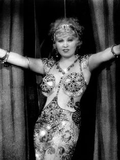 Mae West in her 'carnival performer dress' designed by Travis Banton for 'I'm No…