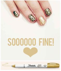 Gold and black line nail art