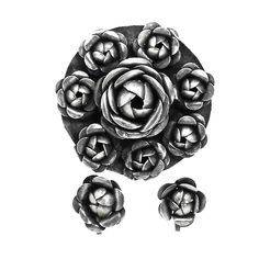 "Vintage Cabbage Roses Brooch Earring Set Mexico Silver Shabby Chic  Vintage Mexico silver roses brooch and screw back earring set. Brooch has a large central rose surrounded by 7 smaller roses. Oxidized silver set has lovely detail; nice shabby chic look. Brand: Made in Mexico Material: silver Approximate Size: Brooch 2"" diameter Condition: very good, pre-owned Your purchase will be shipped in an attractive jewelry gift box.    #BroochesAndPins #1950s #earrings #EarringsScrewback #brooch…"