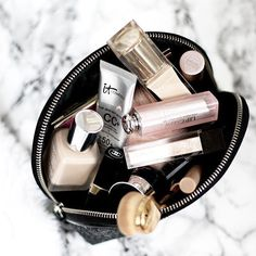 this makeup bag is so pretty   makeup bag essentials products favorites marble beauty