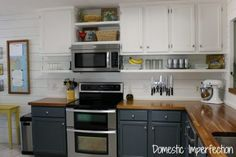 raise cabinets and put open shelving underneath