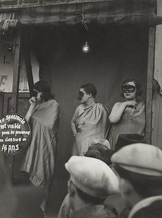 Ladies on the Bally stage in disguise Brassaï Street Fair Boulevard St Jacques Paris 1931