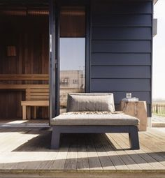 Piet Boon - black siding with weathered teak deck
