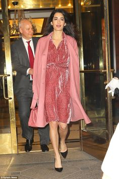 Stepping out in style: Amal Clooney proudly displayed her growing bump as she attended a charity event in New York on Wednesday night