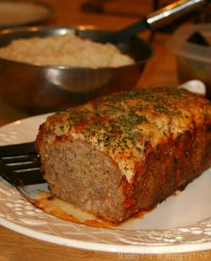 Parmesan Meatloaf  1 lb ground beef, 1 lb ground turkey, 2 eggs, ¼ cup breadcrumbs, ½ tsp dried basil, ½ tsp dried thyme, ½ tsp dried oregano, 1 finely minced clove garlic, 1 small grated onion, ½ tsp salt, ¼ tsp ground black pepper, ½ cup grated Parmesan cheese, ½ cup marinara pasta sauce, ½ cup shredded Italian cheese blend