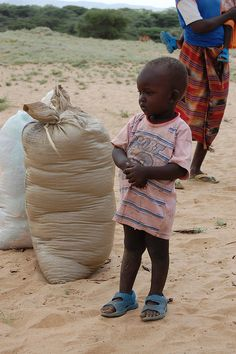 What it's all about. Kenyan child watch as his mother receives much needed food by servinternational, via Flickr