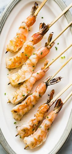 Easy grilled shrimp basted with garlic butter. It's shrimp on a stick! On SimplyRecipes.com