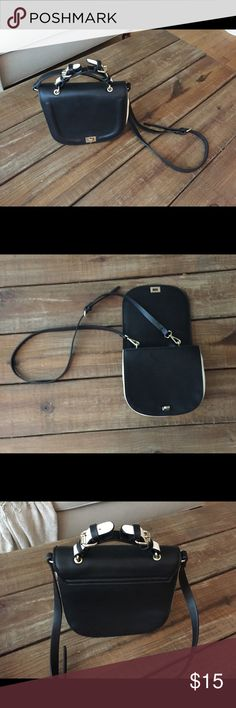 Zara black and white purse This crossbody purse is so pretty! The buckles still work and aren't tarnished. The bottom of the purse has a mark on it. It's barely even noticeable. Other than that it is very clean. Zara Bags Crossbody Bags