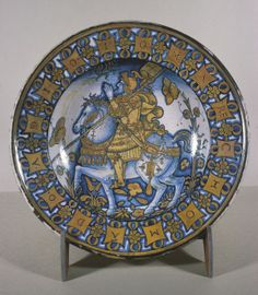 DIsh with Constantine the Great, Deruta, Italy, Workshop of Giacomo Mancini (Italian, active ca. 1540-1560), ca. 1530-1545 earthenware with tin glaze (maiolica) and luster decoration, 8.4 x 40 cm, The Walters Art Museum 48.1740