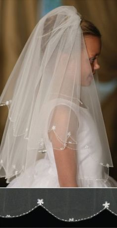 Both stylish and traditional, this white First Communion veil will flatter any hairstyle! The two tiered layered veil is adorned with clear sequins and