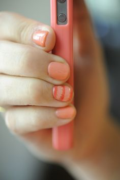 Striped salmon pink/orange nails.