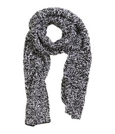 Soft, cable-knit scarf. Size 13 x 78 3/4 in.