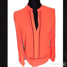 Womens Michael Kors Orange Blouse Womens Michael Kors Orange Blouse  This classic Michael Kors blouse is made from 100% polyester. One thing's for sure – when you choose this womens top, you won't want to go back to your regular clothes. Machine washable.  Material: 100% Polyester Size Medium Color: Orange Long sleeve with open design Tunic style Split v-neckline Sheer material Cool and comfy Michael Kors Tops Blouses