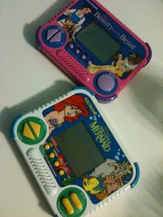 Hand Held Video Games- I had both of these, I think. I KNOW I had the little mermaid one.